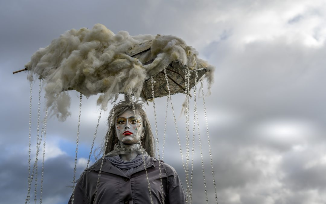 Sculpture of a woman with rain clouds over her head