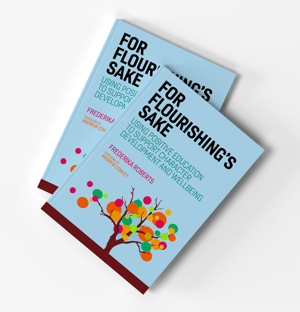 Two copies of the book For Flourishing's Sake, by Frederika Roberts