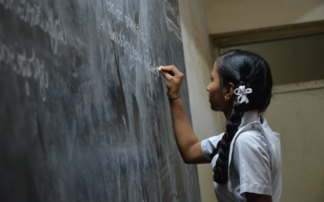 A girl writing on a blackboard