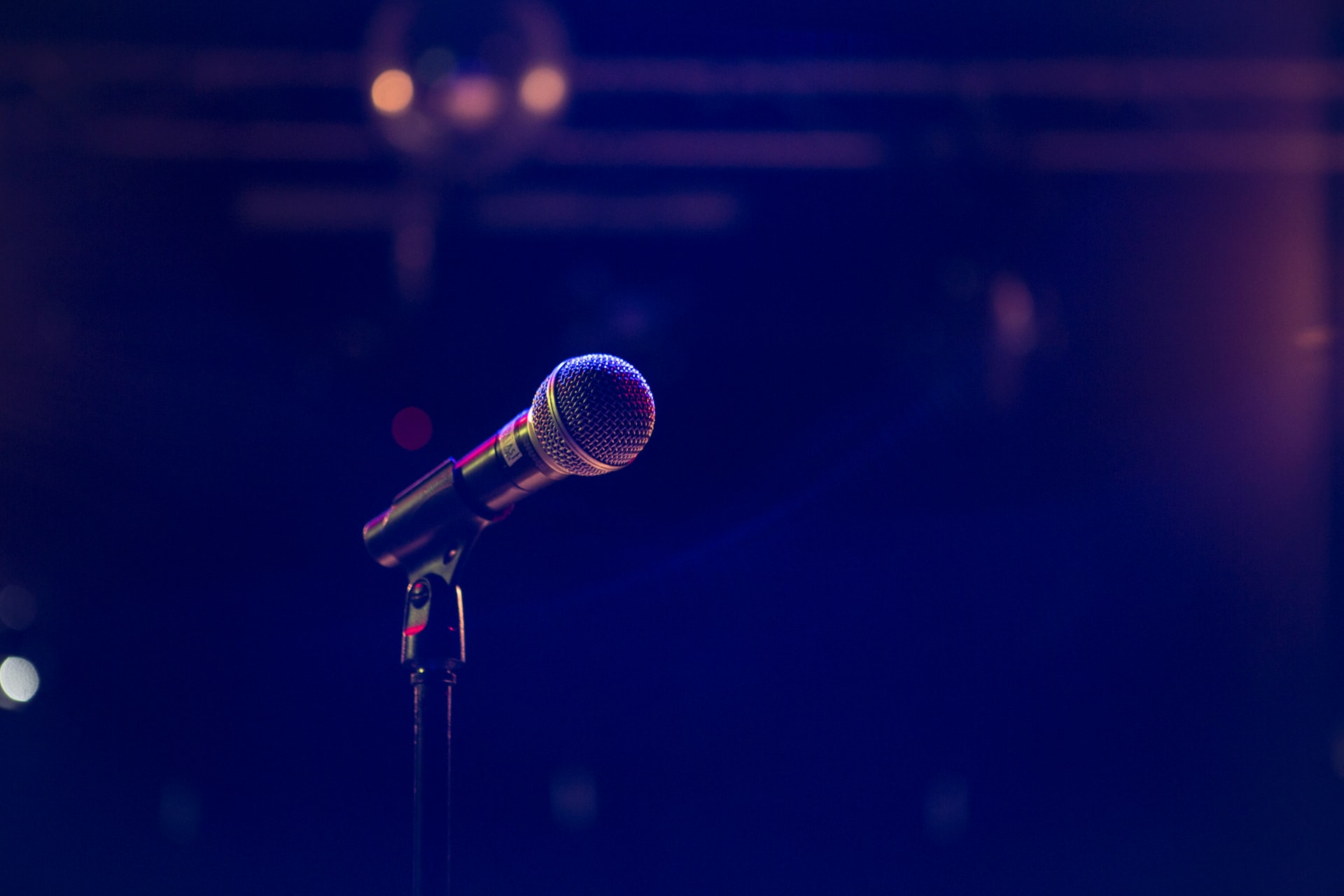 A microphone on a dark stage