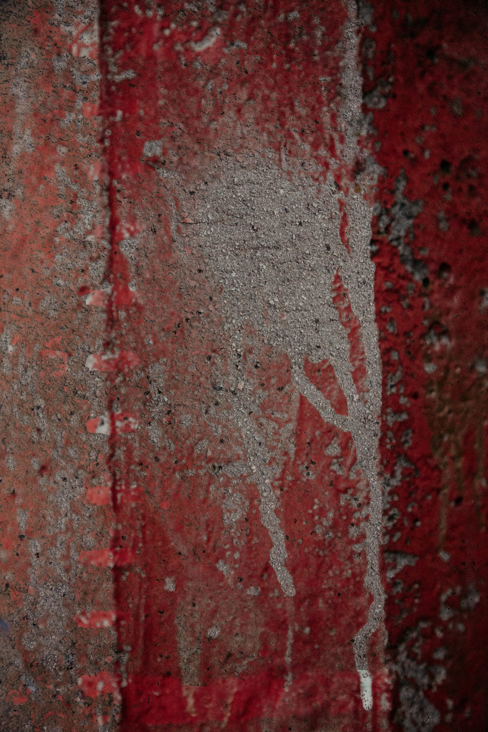 abstract image of rust red paint on concrete